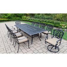 oakland living cast aluminum 11 piece rectangular patio dining set with spunpoly beige cushions