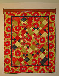 easyDisplay Decorative Quilt Hanger - Instructions & If needed – center and straighten quilt after attaching hanger to wall.  Quilt can slide with magnets attached. Adamdwight.com