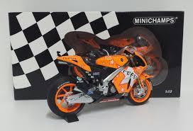 Bikes: MINICHAMPS ANDREA DOVIZIOSO 1/12 #4 MODEL BIKE MOTOGP HONDA RC212V  REPSOL TEAM GP ARAGON 2011 NEW