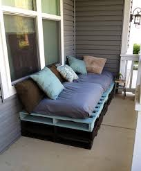 outdoor pallet furniture ideas black wooden sofa colorful decorative pillows
