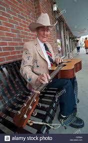 Gospel singer Lester Parrish plays his guitar on the sidewalks of ...