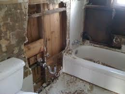 demolition of old bathroom walls tile and tub