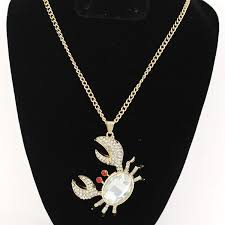picture of necklace gold tone necklace with crab pendant pendant features clear rhinestone accents