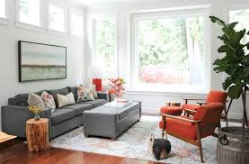 transitional living room grey sectional multicolored throw pillows grey ottoman coffee table tree trunk side tables