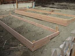 raised garden beds on slope with a