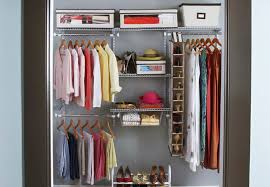 closet with storage containers on the top shelf
