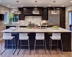 wonderful dark kitchen cabinets with light countertops with brown floor