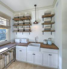 laundry sink cabinet laundry room beach style with metal shelf bracket wicker baskets beach style laundry room