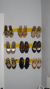 stick them on the molding where you want your shoes to hang these squares can be found on the aisle with the things you put under furniture to get it to