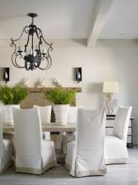 parson chair slipcover dining room transitional with decor bird black iron chandelier exposed beam light potted plants white