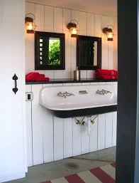 rustic bathroom decor ideas white wall paneling and wooden framed mirror for rustic bathroom decor ideas and style with best plumbing design with black