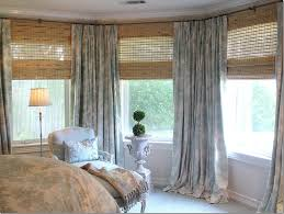 how to hang dry in a bay window how to hang curtains over large window