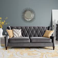 modern artwork wall decors over double seat gray sofa and cushions with fl accent carpet in modern grey living room theme