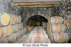 storage oak wine barrels. In A Large Underground Cellar With Stone Arches, Stored Oak Wine Barrels. Storage Barrels