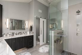 contemporary gray master bathroom with glass shower