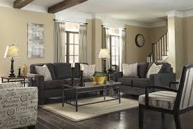 dark wood furniture. Living Room With Dark Wood Floors And Grey Furniture Under Stairs W