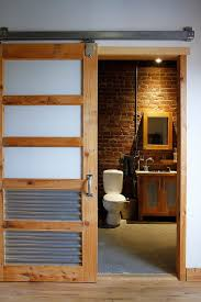 sliding barn doors for bathroom. Perfect Door For The Industrial Bathroom With Salvaged Style [Design: Esther Hershcovich] Sliding Barn Doors
