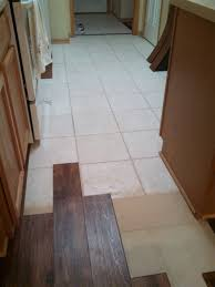 can you put laminate flooring over tile look vinyl