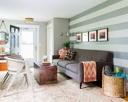 ... Beautiful living room looks perfect with a simple sofa and a striped  accent wall [Design