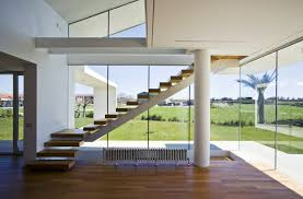 Villa T INterior With Hardwood Flooring And Floor To Ceiling Glass .