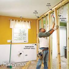 build a temporary support wall to hold the ceiling up when you install the load bearing beam
