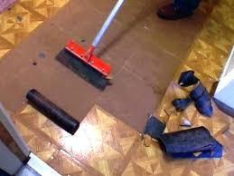 removing vinyl tile how to remove vinyl tile step 2 remove remaining floor backer once vinyl