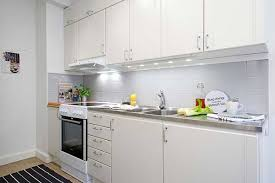 view in gallery white kitchen with stainless steel countertops