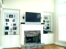 how to mount tv above fireplace hiding wires brick installation hide hang firep how to mount tv