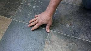 laying tile over vinyl installing tile over vinyl flooring on wood or concrete homeowner laying vinyl