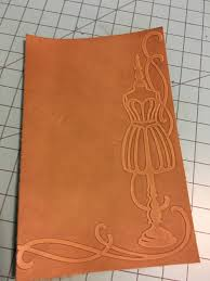 then i did a little experimenting with waterstain a fairly new product at tandy leather and sand paper i sort of like the effects