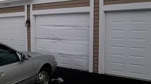 an emergency garage door repair we fixed in wheaton,il * HIT DOOR ...