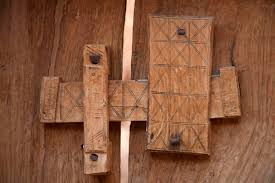 close up of locking system of a wooden door in chinguetti chinguetti mauritania