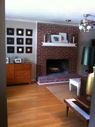paint red brick fireplace black ideas