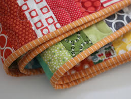 Machine Binding Tutorial | Cluck Cluck Sew & It's a very easy and fast method to sewing bindings, and it looks way  better than sewing the binding down on the front of the quilt with a  visible seam line ... Adamdwight.com