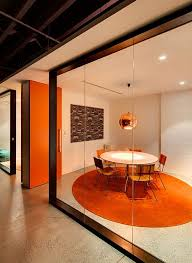 fun office room. fun concept for meeting room can be pitchen green color the doors glass office