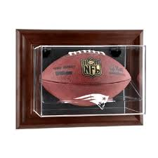brown framed wall mounted football case with nfl team logo us markerboard