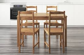 the ikea jokkmokk table and chairs in a light filled kitchen
