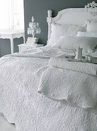 Bedroom: Quilted Bedspreads With White Color And White Paint Walls ... & Off White French Style quilted bedspreads with white side table and gray  paint walls also white Adamdwight.com