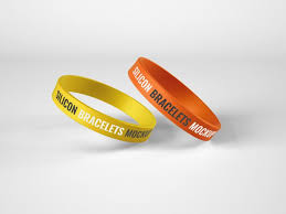 Mockup of three event wristbands against a minimalist surface. Silicone Rubber Bracelet Mockup Paid Paid Ad Rubber Bracelet Mockup Silicone In 2020 Silicone Bracelets Rubber Bracelets Wristband