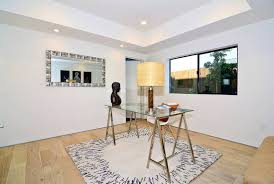 modern santa monica home mid sized modern home office idea with white walls light hardwood floors astounding home office decor accent astounding