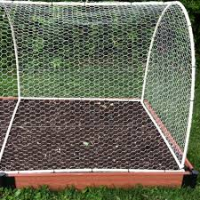 my husband designed this cover to keep squirrels rabbits out of our raised vegetable beds it is made from 1 2 pvc pipe pvc fittings