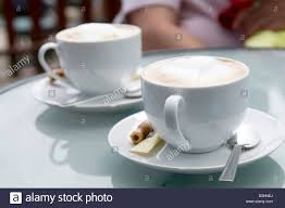 two coffee cups with coffee. Interesting Coffee Two Coffee Cups On Outdoor Restaurant Table  Stock Image On Coffee Cups With