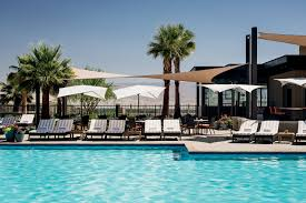pool bar. Pool Overlooked By Palm Trees And Lounge Chairs Bar