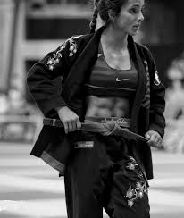 Angelica Galvao is a BJJ black belt with abs of steel. Badass.