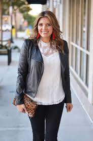leather and lace outfit white lace top with black leather moto jacket and black jeans