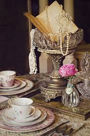 vine wedding centerpieces ideas with pearls silver old books and crystal