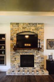 stone fireplace. 3 tags Contemporary Living Room with Hardwood floors,  Rustic fleur de lis wall decor, Built-