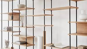moebe creates flexible shelving system held together by wooden wedges