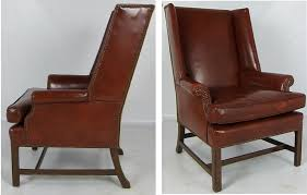 fantastic pair of leather wing back club chairs with their original beautifully worn leather upholstery