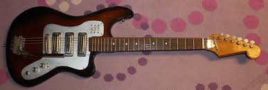 "late 1960s kawai teisco ese electric guitar drowning in i call this one my ""glass"" guitar another pawn shop prize this guitar has a really odd finish it s coated in the typical poly finish of the time"